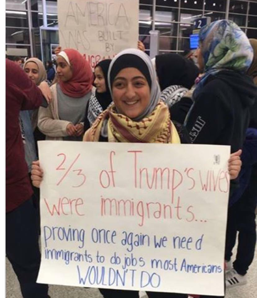 trump-wives-immigrants-sign